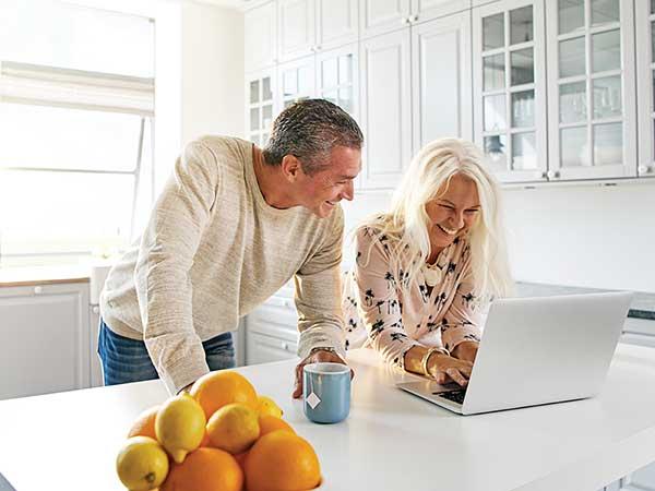 Couple scheduling a hearing evaluation online with Hearing Services